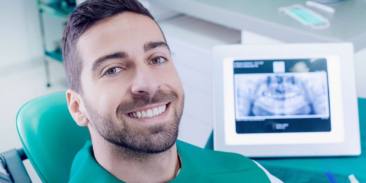 Smiling Male Patient with Xray In Background